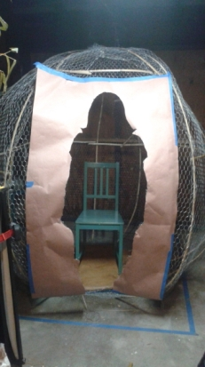 Oops! Looks like I've gained a few pounds! Because I cut out a large portion of the poultry wire, I no longer had tension in the middle and being that the structure is still somewhat curved, it also didn't help. Oh well. The chair was initially there for scale, but a lot of people liked the chair there. I'm not sure if it will be there or not in its final version.